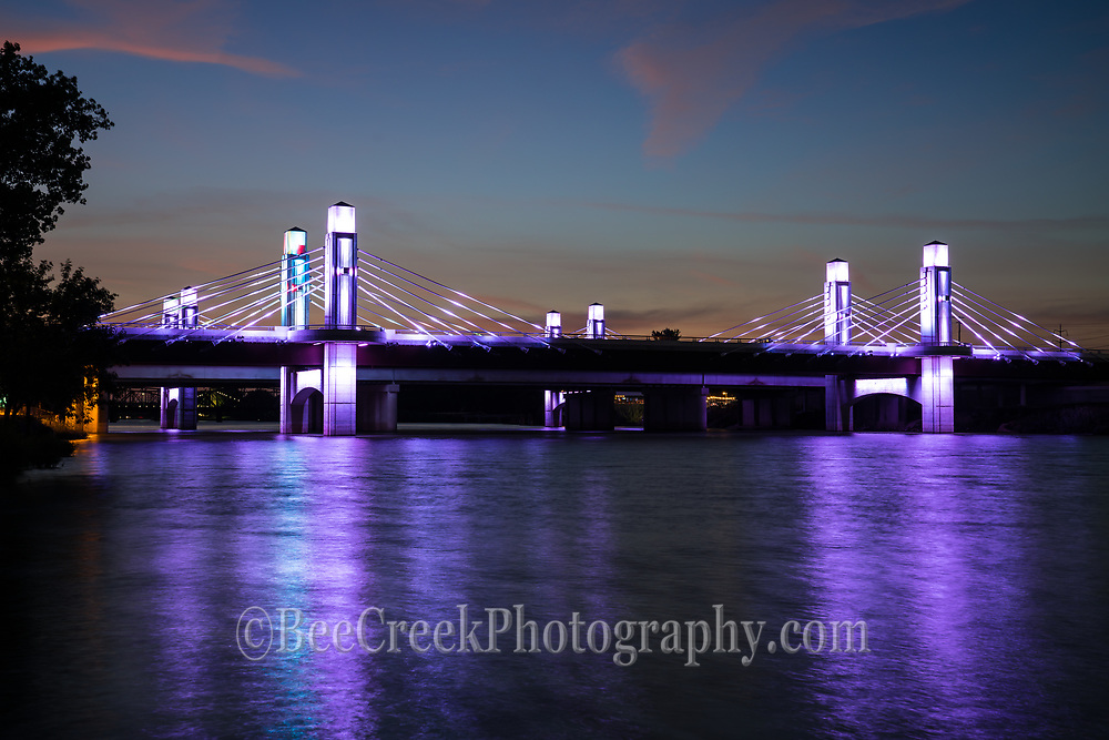 From this angle we were able to capture  these led lights of the Waco stay bridge over the Brazos river as they were changing to their purple stage  after dark with just a hint of color from the sunset still in the sky.  Even the water pick up these wonderful color from the bridge after dark that run over the Brazos river. The highway through Waco is called the Jack Kultgen Freeway named after a civic leader and philanthropist who did a lot of work for charities in Waco for six decades.