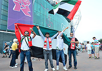 July 26, 2012..Supporters hold flag of UAE at the Old Trafford before round one match between UAE vs Uruguay in Manchester, England. Uruguay defeat United Arab Emirates 2-1.