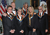 Washington, DC - December 6, 2008 -- 2008 Kennedy Center homorees pose for the formal group photo following the Artist's Dinner at the United States Department of State in Washington, D.C. on Saturday, December 6, 2008.  Front row from left to right: Twyla Tharp, Morgan Freeman, and Barbra Streisand.  Back row from left to right: Roger Daltrey, Pete Townshend, and George Jones..Credit: Ron Sachs - Pool via CNP