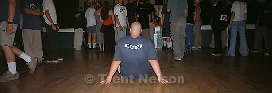 Straightedge kid with &quot;belcher&quot; on his shirt, sitting down in the pit at Fury 66 show at the Whittier Community Center.<br />