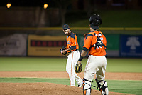 AZL Giants relief pitcher Olbis Parra (72) laughs with catcher Ricardo Genoves (15) during a game against the AZL Angels on July 10, 2017 at Scottsdale Stadium in Scottsdale, Arizona. AZL Giants defeated the AZL Angels 3-2. (Zachary Lucy/Four Seam Images)