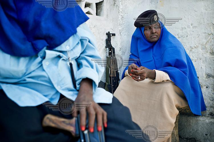 A portrait of policewoman Khadija Haji Diriye sitting with a colleague in Mogadishu.