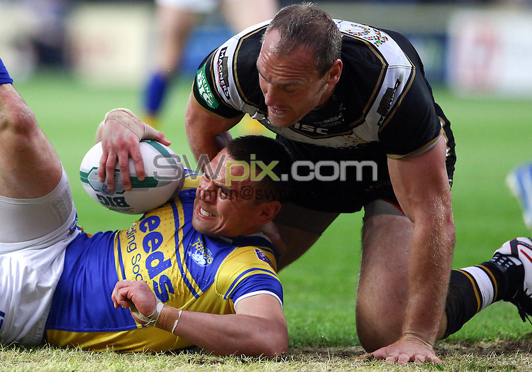 PICTURE BY ALEX WHITEHEAD/SWPIX.COM - Rugby League - Super League - Hull FC vs Leeds Rhinos - KC Stadium, Hull, England - 31/05/13 - Leeds' Kevin Sinfield is tackled by Hull FC's Gareth Ellis.