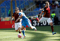 Calcio, Serie A: Roma vs Napoli. Roma, stadio Olimpico, 25 aprile 2016.<br /> Napoli&rsquo;s Dries Mertens, left, is chased by Roma's Miralem Pjanic during the Italian Serie A football match between Roma and Napoli at Rome's Olympic stadium, 25 April 2016.<br /> UPDATE IMAGES PRESS/Riccardo De Luca