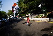 A young boy is seen running with a Congress party flag as the results are declared and their party's victory at the Indian general elections outside the All India Congress Committee office in New Delhi, India. ..India's governing Congress party was headed to a resounding victory Saturday, May 16th 2009 in the monthlong national elections.