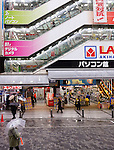 People in the rain on the street in front of Labi store at Akihabara, Tokyo, Japan.