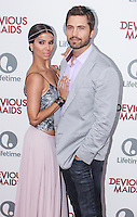 PACIFIC PALISADES, CA - JUNE 17: Roselyn Sanchez and Eric Winter attend the Lifetime original series 'Devious Maids' premiere party held at Bel-Air Bay Club on June 17, 2013 in Pacific Palisades, California. (Photo by Celebrity Monitor)