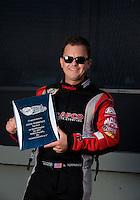 Sep 13, 2013; Charlotte, NC, USA; NHRA top fuel dragster driver Steve Torrence during qualifying for the Carolina Nationals at zMax Dragway. Mandatory Credit: Mark J. Rebilas-