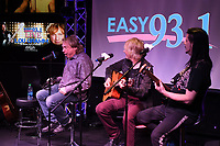 HOLLYWOOD, FL - MARCH 08: Lou Gramm performs with Jeffrey Kollman and John Payne of Aisa during Easy Live at radio station Easy 93.1 on March 8, 2019 in Hollywood, Florida.    <br /> CAP/MPI04<br /> &copy;MPI04/Capital Pictures