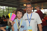 Hospitality Hall at Manhattan College with origami Model Menu for classes. First timers, father and son: Jay (left) and Sandeep Nabar, OK.
