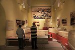 Two men looking at display of neolithic finds, National Museum of Archaeology, Valletta, Malta