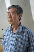 Dr. Kaw Bing Chua, Senior Principal Investigator and Program Director of Temasek Lifesciences Laboratory poses for a portrait at a pig farm in Ipoh, Perak, Malaysia on October 15th, 2016. <br /> In September 1998, a virus among pig farmers (associated with a high mortality rate) was first reported in the state of Perak in Malaysia. Dr. Chua investigated and discovered the virus and it was later named, Nipah Virus. The outbreak in Malaysia was controlled through the culling of &gt;1 million pigs.