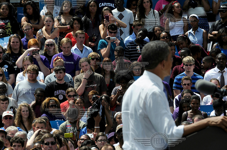 President Barack Obama at an Democratic Party election rally at Capital University in Columbus, Ohio. During his speech, Obama accused Mitt Romney of planning to slash education funding. Obama's key word for this election is 'Forward'.