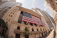The New York Stock Exchange sports a giant American flag for the July 4th holiday on Friday, July 3, 2015.  (© Richard B. Levine)