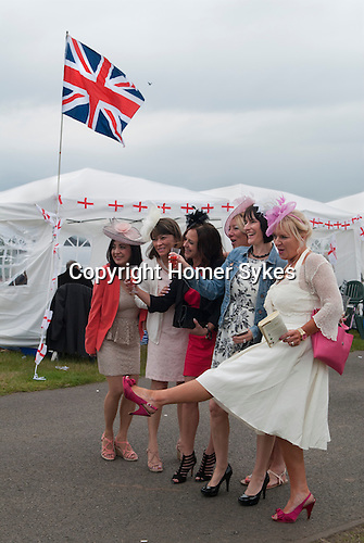 Royal Ascot horse racing Berkshire. 2016 Celebrating woman in white (foreground) birthday, group of hospital workers away day from Nottinghamshire. Heath side of racecourse.