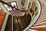 """The spiral staircase is located at the entryway.  """"At Home"""" with Margaret Lowery in her Lake Christine Drive home in Belleville, IL on July 24, 2019. <br /> Photo by Tim Vizer"""
