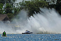 "Frame 3: Kevin Kreitzer, A-64 ""Blue Devil"" hooks in turn 2 and blows some decking off the boat. (2.5 MOD class hydroplane(s)"
