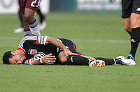 D.C. United forward Dwayne de Rosario (7) goes down after a hard tackle. D.C. United defeated the Colorado Rapids 2-0 at RFK Stadium, Wednesday May 16, 2012.
