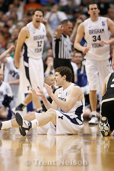 Trent Nelson  |  The Salt Lake Tribune.BYU's Jimmer Fredette celebrates a call in the first half as BYU faces Wofford in the NCAA Tournament, men's college basketball at the Pepsi Center in Denver, Colorado, Thursday, March 17, 2011. In the background are BYU's Logan Magnusson, left, and Noah Hartsock.