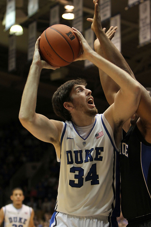 Ryan Kelly attempts to shoot a layup. Duke beat Presbyterian 96-55 on Saturday, November 12, 2011 at Cameron Indoor Stadium in Durham, NC. It was win number 902 for Duke head coach Mike Krzyzewski, tying him with Bob Knight for the NCAA Division I all-time win record. Photo by Al Drago.