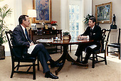 Washington, D.C. - February 10, 1988 -- United States President Ronald Reagan talks with Vice President George H.W. Bush over lunch on February 10, 1988 in the Oval Office Study at the White House in Washington, DC..Credit: White House via CNP