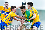 David Clifford Kerry in action against Sean Rouine and Jamie O'Sullivan Clare in the Munster Minor Quarter Final at Austin Stack Park Tralee on Wednesday night.
