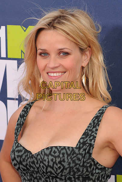 Reese Witherspoon.The 2011 MTV Movie Awards held at Universal Studios Gibson Amphitheatre, Universal City, California, USA..June 5th, 2011.headshot portrait green grey gray black print dangling gold earrings.CAP/ROT/TM.©Tony Michaels/Roth Stock/Capital Pictures