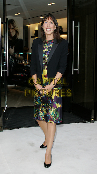 SAMANTHA CAMERON.Vogue 'Fashion's Night Out ' launch at Burberry's store in New Oxford Street, London, England..September 10th 2009.full length black jacket purple green yellow pattern print dress .CAP/ROS.©Steve Ross/Capital Pictures.