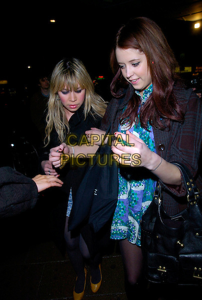 PEACHES GOLDOF & GUEST.LG Shine - launch party, Club Cirque, Leicester Square, London, UK..February 7th, 2007.full length brown tweed jacket purple white green pattern print polka dot dress black bag purse arms linked coat yellow shoes.CAP/CAN.©Can Nguyen/Capital Pictures