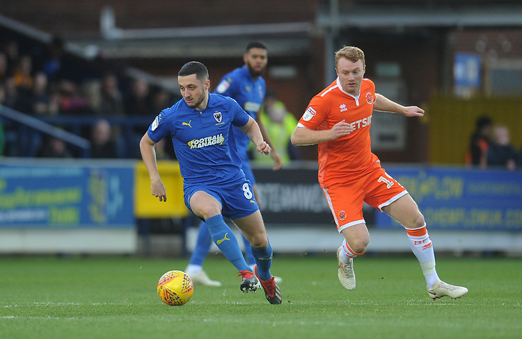 AFC Wimbledon's Anthony Hartigan under pressure from Blackpool's Chris Taylor<br /> <br /> Photographer Kevin Barnes/CameraSport<br /> <br /> The EFL Sky Bet League One - AFC Wimbledon v Blackpool - Saturday 29th December 2018 - Kingsmeadow Stadium - London<br /> <br /> World Copyright © 2018 CameraSport. All rights reserved. 43 Linden Ave. Countesthorpe. Leicester. England. LE8 5PG - Tel: +44 (0) 116 277 4147 - admin@camerasport.com - www.camerasport.com