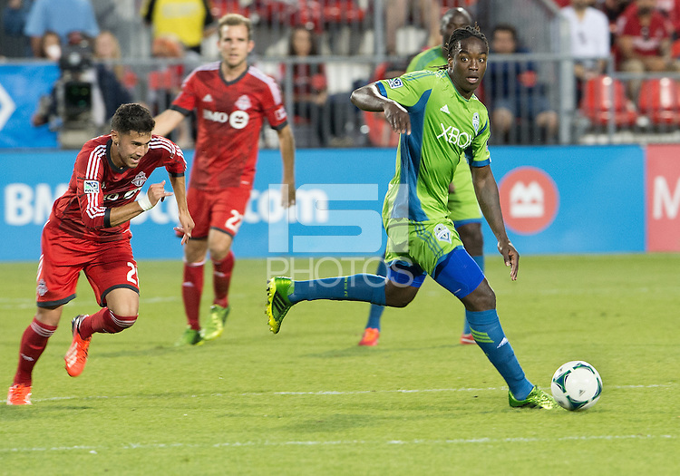 August 10, 2013: Seattle Sounders FC midfielder Shalrie Joseph #21 in action during an MLS regular season game between the Seattle Sounders and Toronto FC at BMO Field in Toronto, Ontario Canada.<br /> Seattle Sounders FC won 2-1.