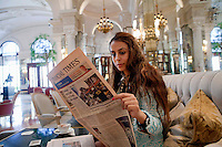 Diana Basfam, student at the International University of Monaco, drinks coffee and reads the newspaper in l'Hotel de Paris, Casino Square, Monte Carlo, Monaco, 19 April 2013. She is a regular visitor to l'Hotel de Paris and comes to the lobby or terrace to study from time to time.