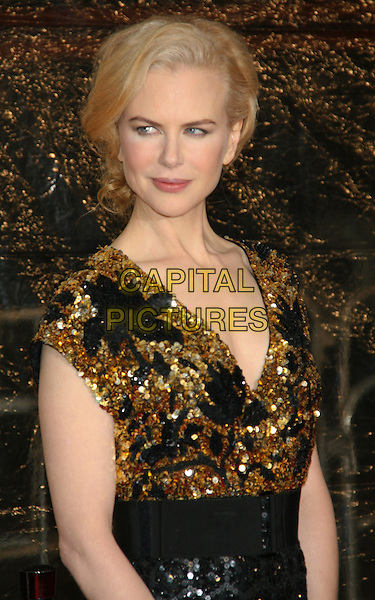"NICOLE KIDMAN .New York Premiere of ""Australia"" at the Ziegfeld Theater, New York, NY, USA..November 24th, 2008.half length black gold sequins sequined dress top.CAP/LNC/TOM.©TOM/LNC/Capital Pictures."