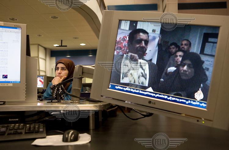 Journalists at work in the newsroom of news channel Al Jazeera in Doha.