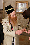 Israel, Jerusalem. Purim at Yeshuot Ya?acov Synagogue in the Me?a She?arim quarter, giving donation, 2005<br />