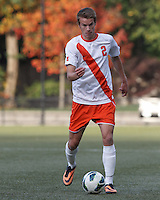 Syracuse University defender Oyvind Alseth (2) looks to pass.Boston College (maroon) defeated Syracuse University (white/orange), 3-2, at Newton Campus Field, on October 8, 2013.