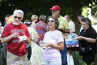NWA Democrat-Gazette/ANDY SHUPE<br /> Visitors participate Saturday, Aug. 15, 2015, in the 44th annual Washington County Historical Society Ice Cream Social at Headquarters House in Fayetteville. The annual event featured music, ice cream, desserts and tours of the Civil War-era house and museum.