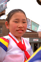 Girl age 7 wearing nations ethnic clothing at Asian American Festival.  St Paul  Minnesota USA