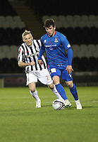 Aaron Doran closely marked by Gary Teale in the St Mirren v Inverness Caledonian Thistle Clydesdale Bank Scottish Premier League match played at St Mirren Park, Paisley on 30.1.13.