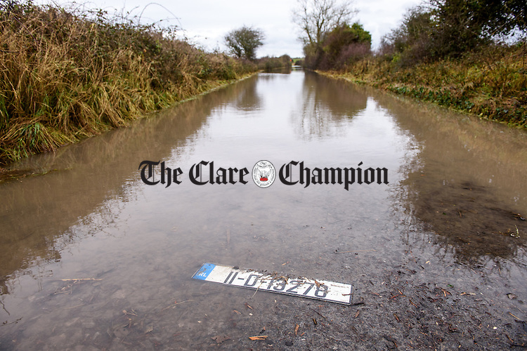 All that remains.. A car's number plate presumably lost in the flood waters on a  flooded and impassable road outside Kinvarra in South Galway. Photograph by John Kelly.