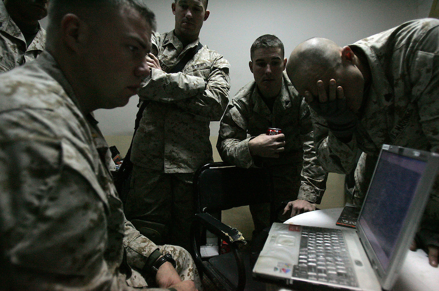 Marines with 2nd Platoon Golf Company 2nd Battalion 5th prepare for a raid on a suspected insurgent propagandist's home - plotting routes and positions  - on January 11, 2005 in Ramadi, Iraq. The raid netted computers, DVDs, and other materials but the target was not apprehended.