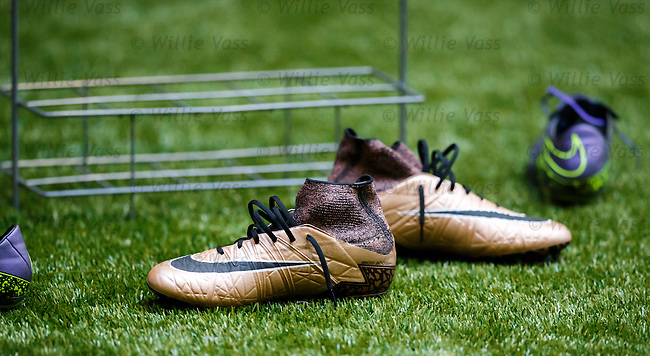 A spare pair of boots on the 4G indoor hall surface