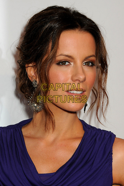 KATE BECKINSALE .TOD's Beverly Hills Boutique Launch Celebration held at TOD's Boutique, Beverly Hills, California, USA, .15th April 2010..portrait headshot hair up earrings starburst dangly  purple  cowel neck make-up .CAP/ADM/BP.©Byron Purvis/AdMedia/Capital Pictures.