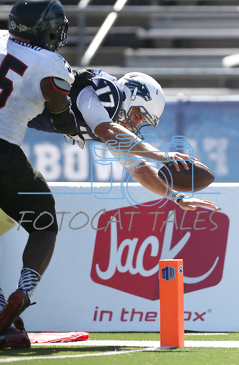 Nevada's Cody Fajardo (17) dives past Southern Utah's Chinedu Ahanonu (35) to score during the second half of an NCAA college football game on Saturday, Aug. 30, 2014 in Reno, Nev. Nevada defeated Southern Utah 28-19. (AP Photo/Cathleen Allison)