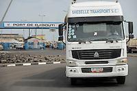 DJIBOUTI, port, most of the goods for or from Ethiopia are shipped via Djibouti, chinese Sinotruck heading for Ethiopia / DSCHIBUTI Hafen, die meisten Waren fuer Aethiopien werden ueber Djibouti verschifft, chinesischer Sinotruck auf Fahrt nach Ethiopien