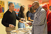 United States President Barack Obama and family serve Thanksgiving meals to homeless and at-risk veterans at the Friendship Place homeless center in the basement of St. Luke's Methodist Church, in Washington, DC, Wednesday, November 25, 2015.  As part of the Administration's focus on reducing the rate of veteran homelessness, Friendship Place received a $3.1 million grant from the Department of Veterans Affairs in 2015. From left to right: President Obama, Malia Obama, first lady Michelle Obama.<br /> Credit: Martin H. Simon / Pool via CNP