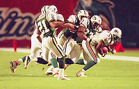 J.J. Johnson carries as the as the Jets defeated the Dolphins 20-3 in Miami , FL on November 19, 2000. (Photo by Brian Cleary / www.bcpix.com)