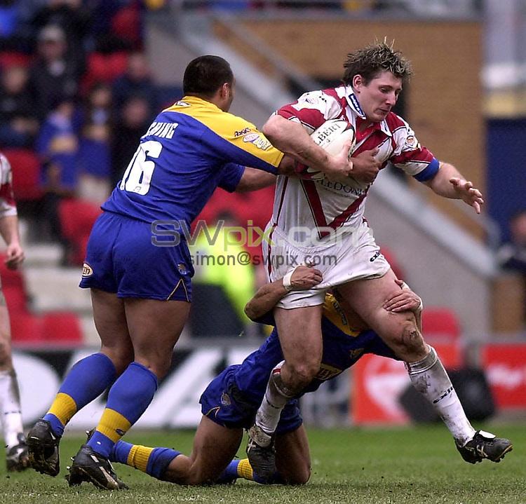 Pix: Matthew Lewis/SWpix.com. Nutri Grain Challenge Cup Semi-Final. Leeds Rhino's v St.Helens. JJB Stadium, Wigan. 14/04/2002...COPYWRIGHT PICTURE>>SIMON WILKINSON>>01943 436649>>..Leeds' Willie Poching tackles St.Helens' John Stankevitch.