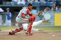 Hagerstown Suns catcher Pedro Severino #4 looks for the ball after having it knocked loss by a hard charging Dillon Thomas #27 during a play at the plate during a game against the Asheville Tourists at McCormick Field on May 28, 2013 in Asheville, North Carolina. The Tourists won the game 9-4. (Tony Farlow/Four Seam Images)