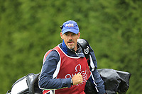 Ricardo Gouveia (POR) caddy Nick Mumford walks off the 9th tee during a wet Saturday's Round 3 of the 2017 Omega European Masters held at Golf Club Crans-Sur-Sierre, Crans Montana, Switzerland. 9th September 2017.<br /> Picture: Eoin Clarke | Golffile<br /> <br /> <br /> All photos usage must carry mandatory copyright credit (&copy; Golffile | Eoin Clarke)
